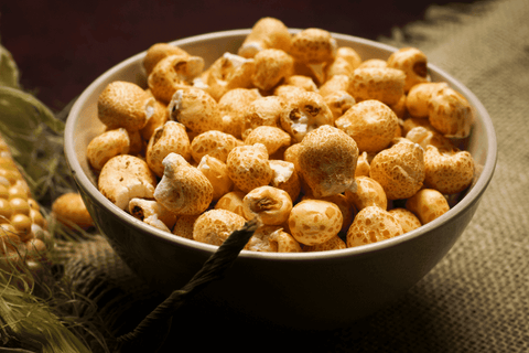 corn puffs in a bowl corn on the side burlap tablecloth
