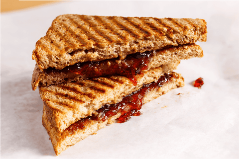 grilled peanut butter and jelly sandwich on wheat bread