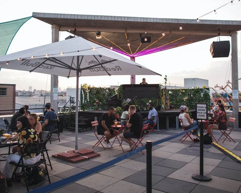 outdoor rooftop bar with stage and DJ covid restrictions