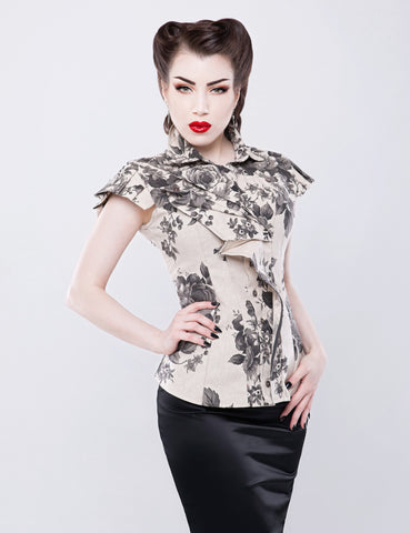 Sculptable floral cap sleeved ticking shirt.