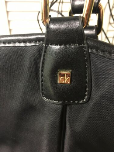 Calvin Klein Black Handbag Multiple Pockets Magnet And Zipper Closures