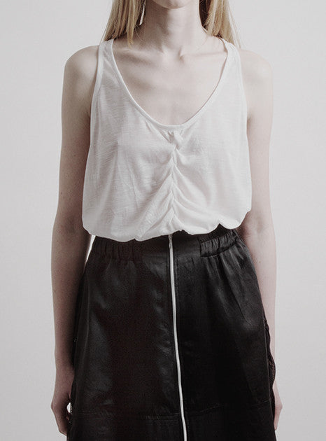 White tank top front by METTE FREJVALD. Minimalist fashion