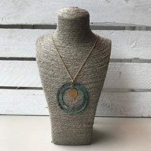 Gold necklace with teal circle pendent