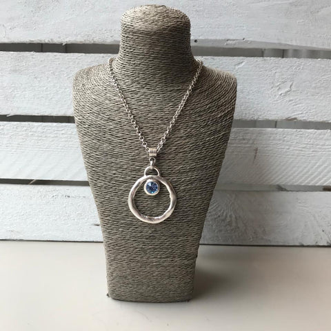 Silver necklace with blue crystal