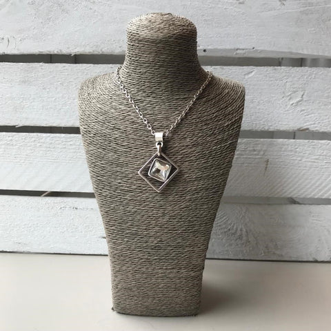Silver necklace with square pendent and clear crystal
