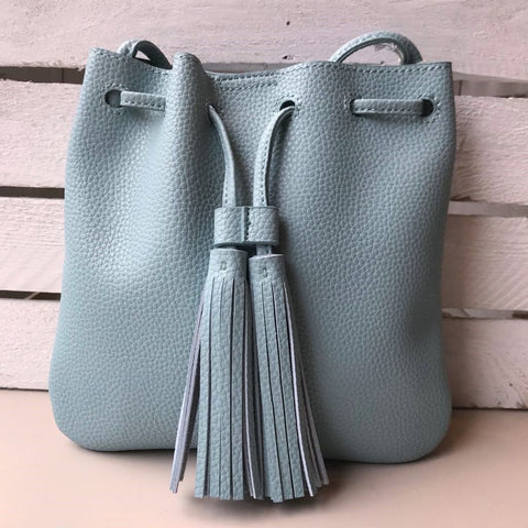Pale blue faux leather crossbody bag with tassels