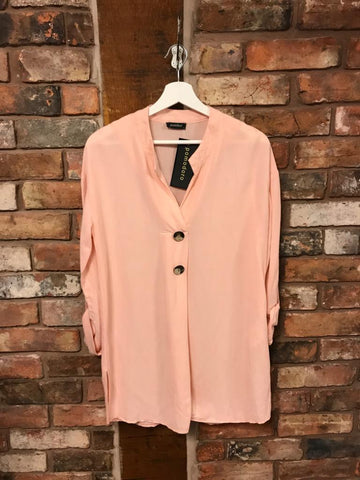 Blush pink shirt with button details and turn up sleeves