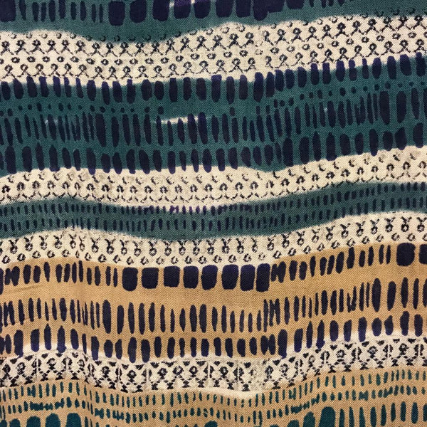 Close up print of Nomads large teal scarf or sarong