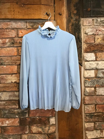 Pale blue pleated blouse