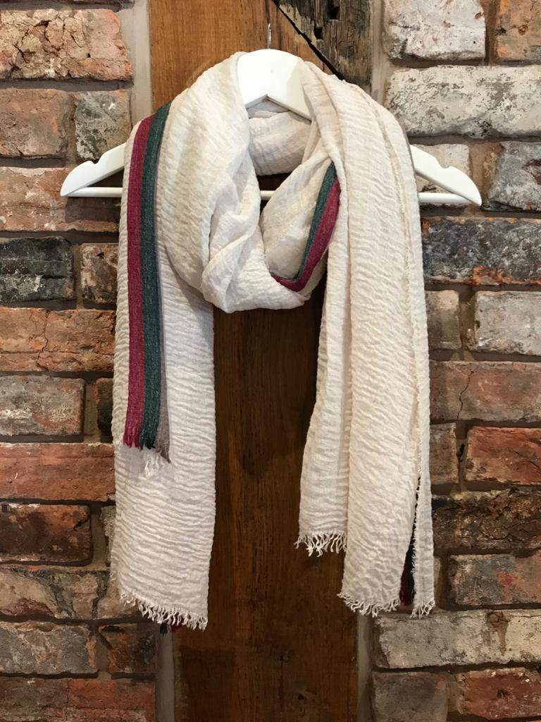 Cream scarf with red & green strip. Crinkle cotton. At Ladies clothes shop Nantwich