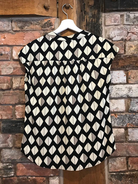 Back shot black & cream diamond print top by Pomodoro
