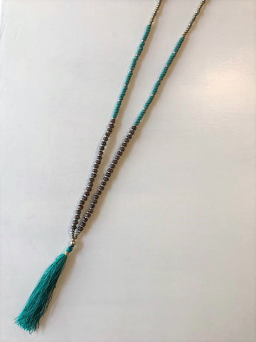 Long beaded necklace with tassel