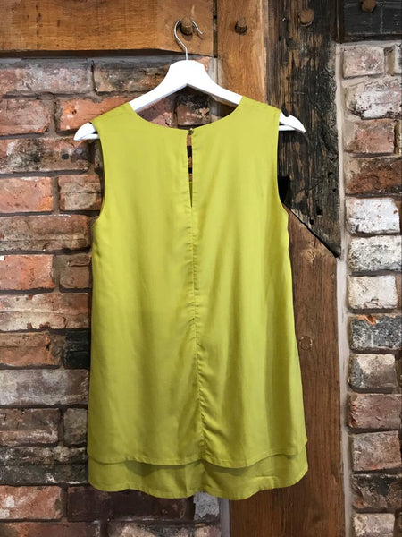 Bright green layered top clothing Nantwich