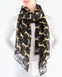 yellow dog print on a black background scarf. model close-up oagainst a white background