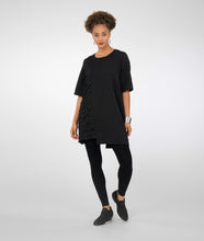 Load image into Gallery viewer, model in black leggings with a black textured tunic with an uneven hemline
