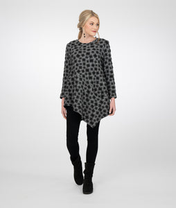 model in a grey tunic with black squares and an angled tunic