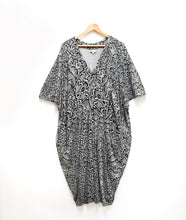 Load image into Gallery viewer, grey and black snake print dress in a vneck kaftan style, on a hanger