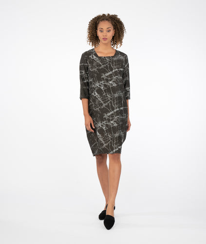 model in a black marble print shift dress with a squared neckline and 3/4 sleeves