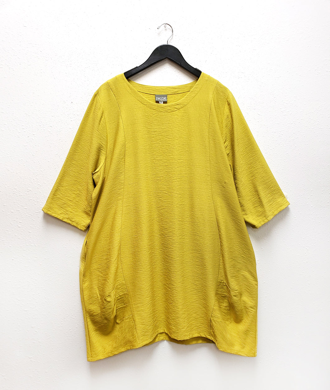 highlight yellow tunic with pleating detail at the hips