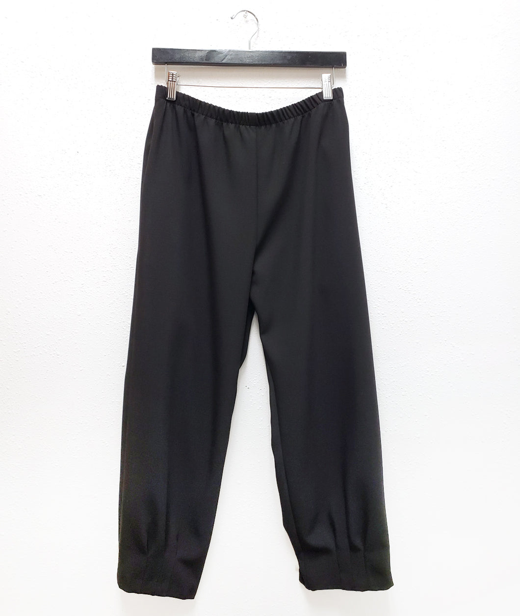 black straight leg pant with a dart detail at the ankle hem
