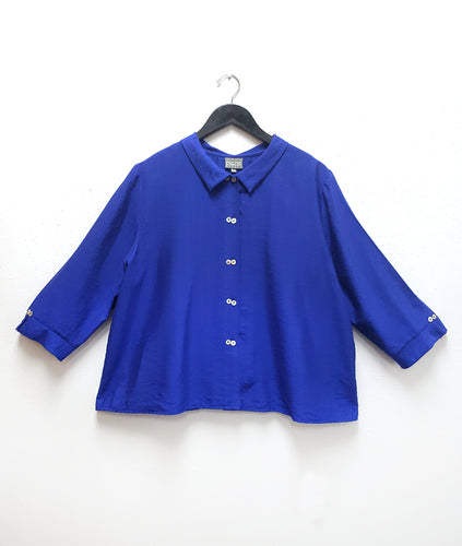 cobalt button up blouse with a twin button detail up the front and at the sleeve cuffs
