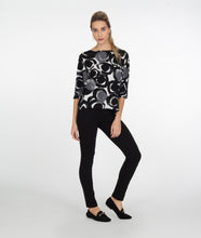 Load image into Gallery viewer, model in a black, white and grey circle print top with a dolman style sleeve