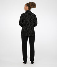 Load image into Gallery viewer, model in a slim black pant with a black boxy cowl neck top with a geometric grey pattern