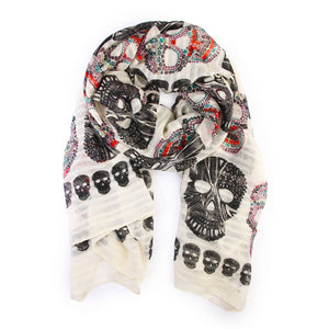 black and multicolored skulls printed on an ivory scarf