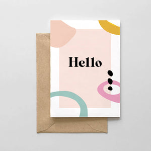 "greeting card with the word ""hello"" in bold black letters on a pastel pink rectangle with various colored shapes around"