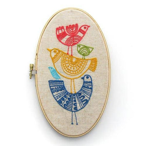 embroidery hoop with a multi color bird design