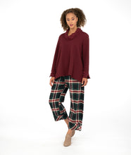 Load image into Gallery viewer, a model in plaid pants with a burgundy top with a cowl neck and sleeve cuffs