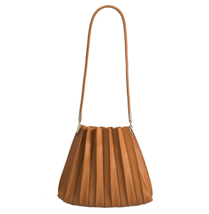 tan handbag with a long strap and a pleated detail