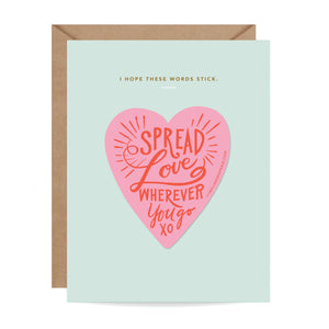 mint color card with a pink heart and text