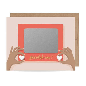 card with a drawing of hands using an etch-a-sketch