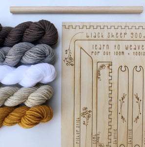bundles of yarn with a wooden loom kit