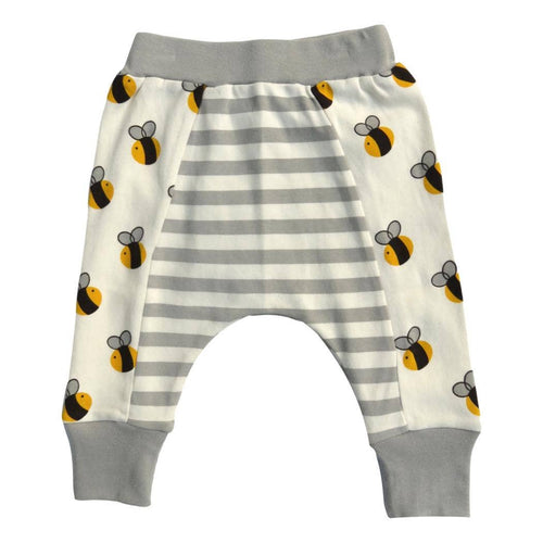 Close up of baby pants. Side panels have black and yellow bee print, solid grey waist band and cuffs, and gry and white stripe center panel. On a white background.