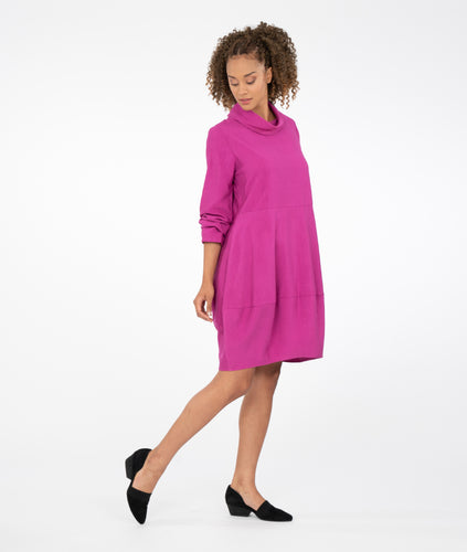 model in a magenta tunic with a cowl neckline