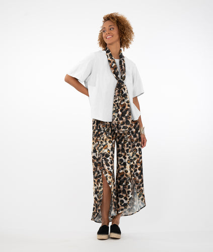 model in a wide leg leopard print pant with a matching scarf around her neck, worn with a boxy white tee