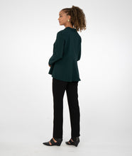 Load image into Gallery viewer, model in a black slim pant with a dark green button up
