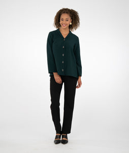 model in a black slim pant with a dark green button up