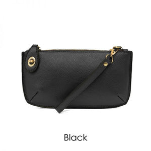 black leather clutch on a white background