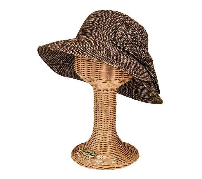 Straw hat with a large bow detail featured on a headform against a white background.