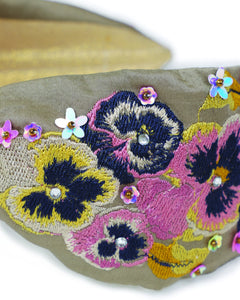 grey headband with different color flowers and sequins embroidered across it