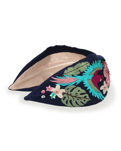 navy blue headband with a flying parrot embriodered on it, surrounded by sequins and flowers