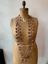 Load image into Gallery viewer, Red rubber necklace on an old mannequin