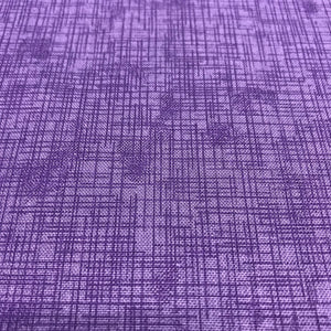 close up of purple crosshatch print pattern with lighter purple background and darker purple crosshatch pattern overlayed on top