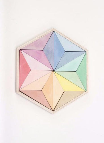 Hexagon shaped box with traignale shaped pastel chalk pieces with white background