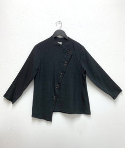 black button up blouse with an asymmetrical placket and a twin button up the front