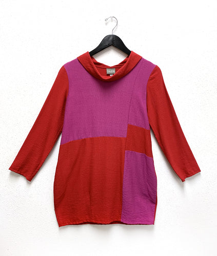 magenta and red colorblocked tunic with a cowl neckline