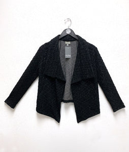 black jacket with a grey geometric print and a large collar